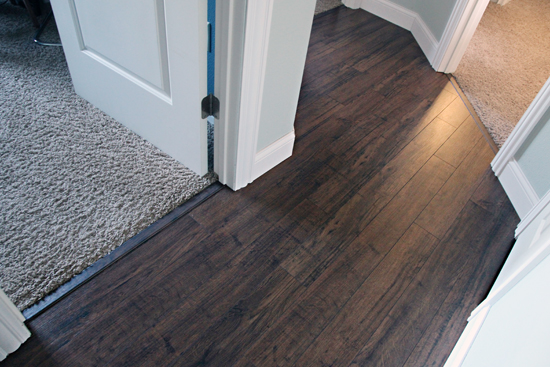 Installing plank flooring kapriz hardwood flooring store for Hardwood over linoleum